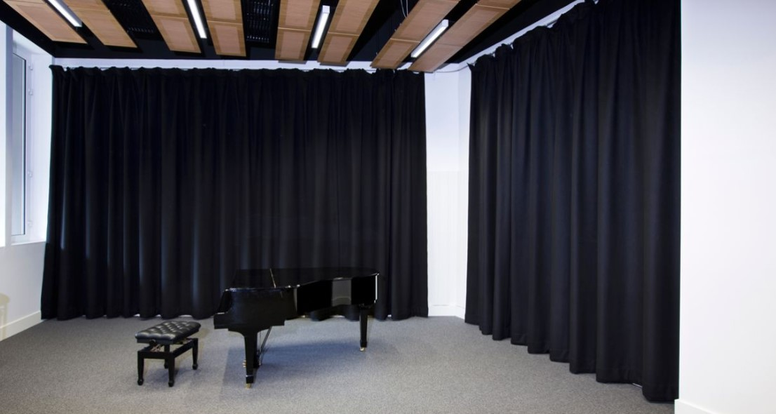 Soundproofing curtains or acoustic treatment